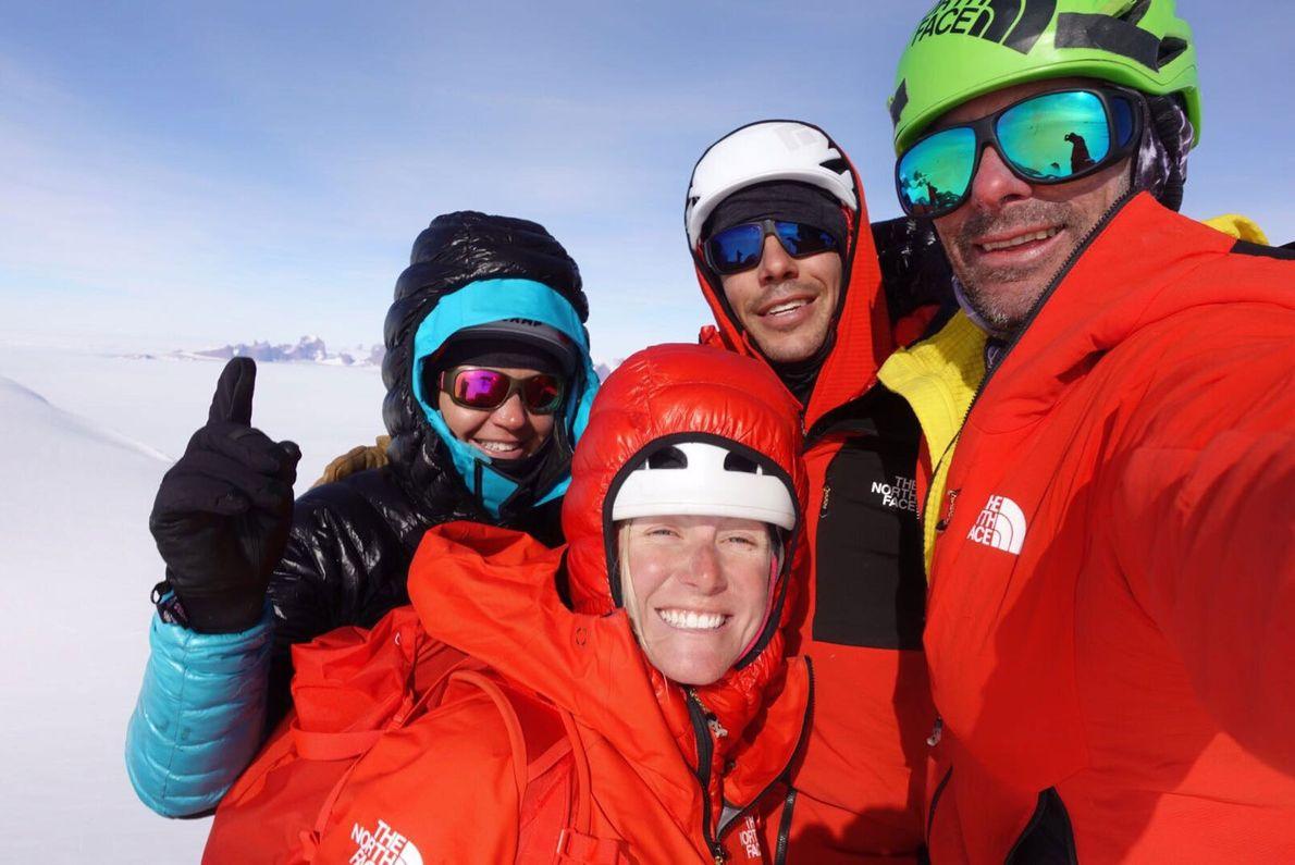 Anna Pfaff, Savannah Cummins, Alex Honnold, and Cedar Wright take a summit selfie atop the Penguin, ...