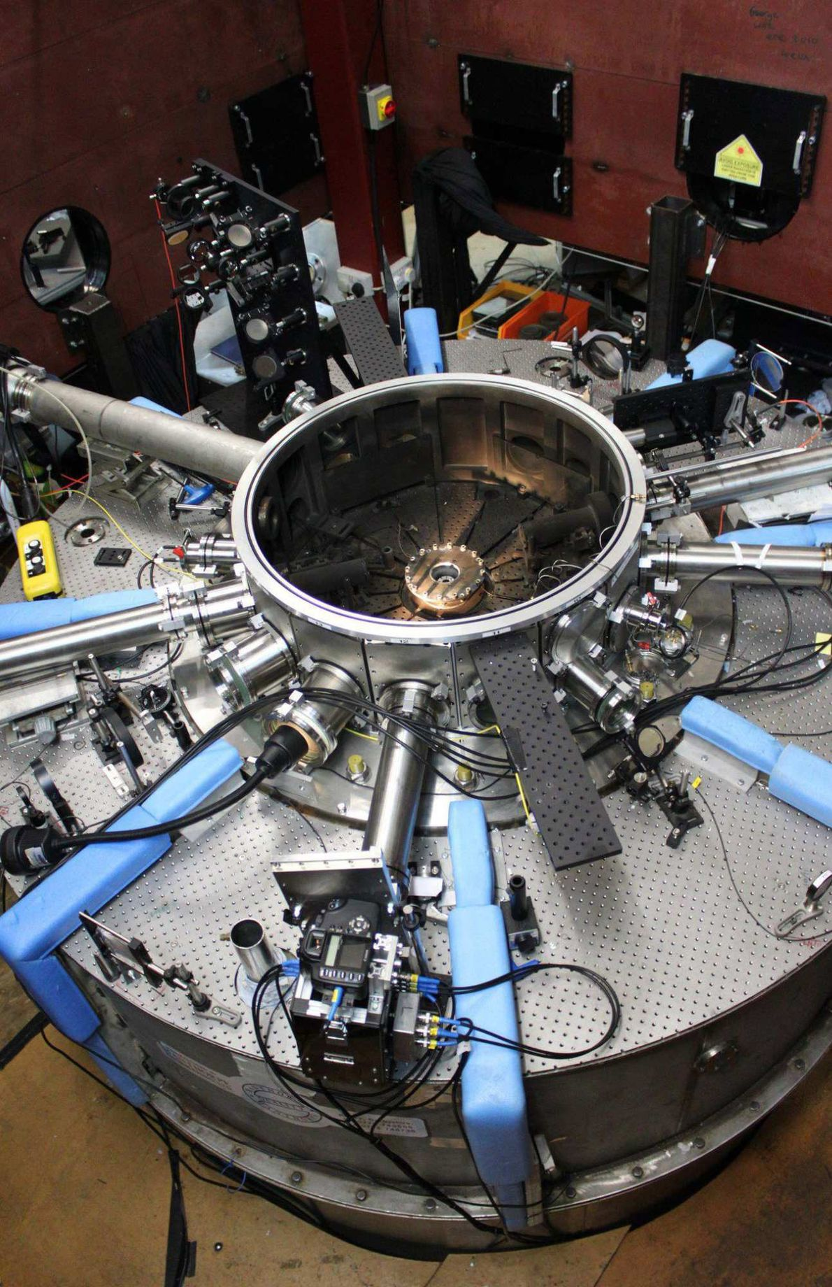 The solar wind simulations are carried out in a vacuum chamber that sits on top of ...