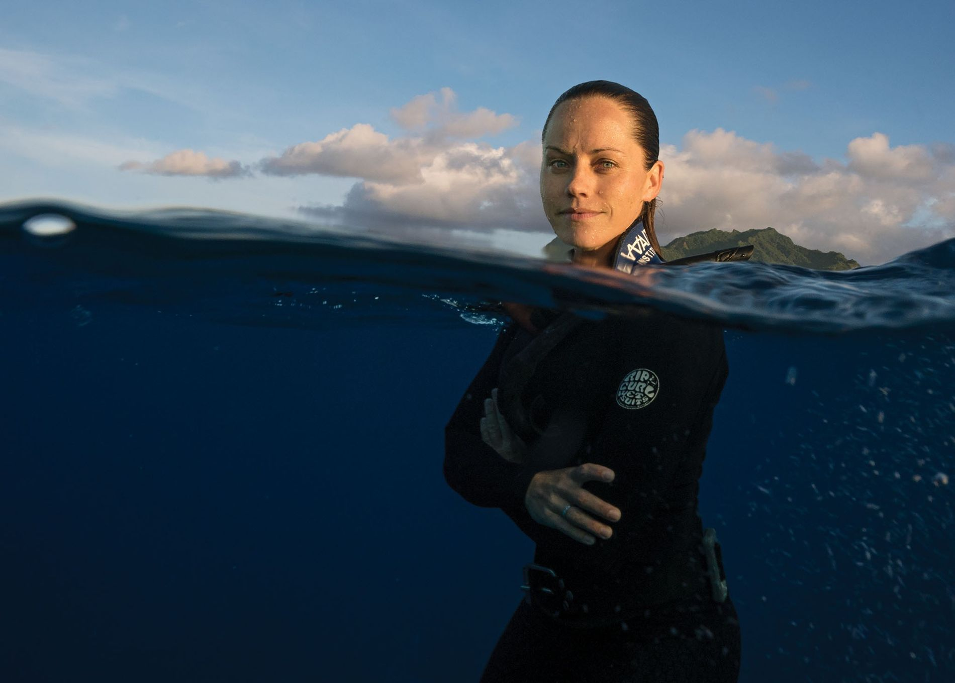 Jessica Cramp free dives off Rarotonga, the largest of the Cook Islands.