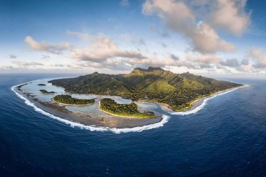 The island of Rarotonga, from above. In 2012 the Cook Islands implemented one of the world's strictest shark sanctuaries. Researcher Jessica Cramp wants to find out: Does it work?