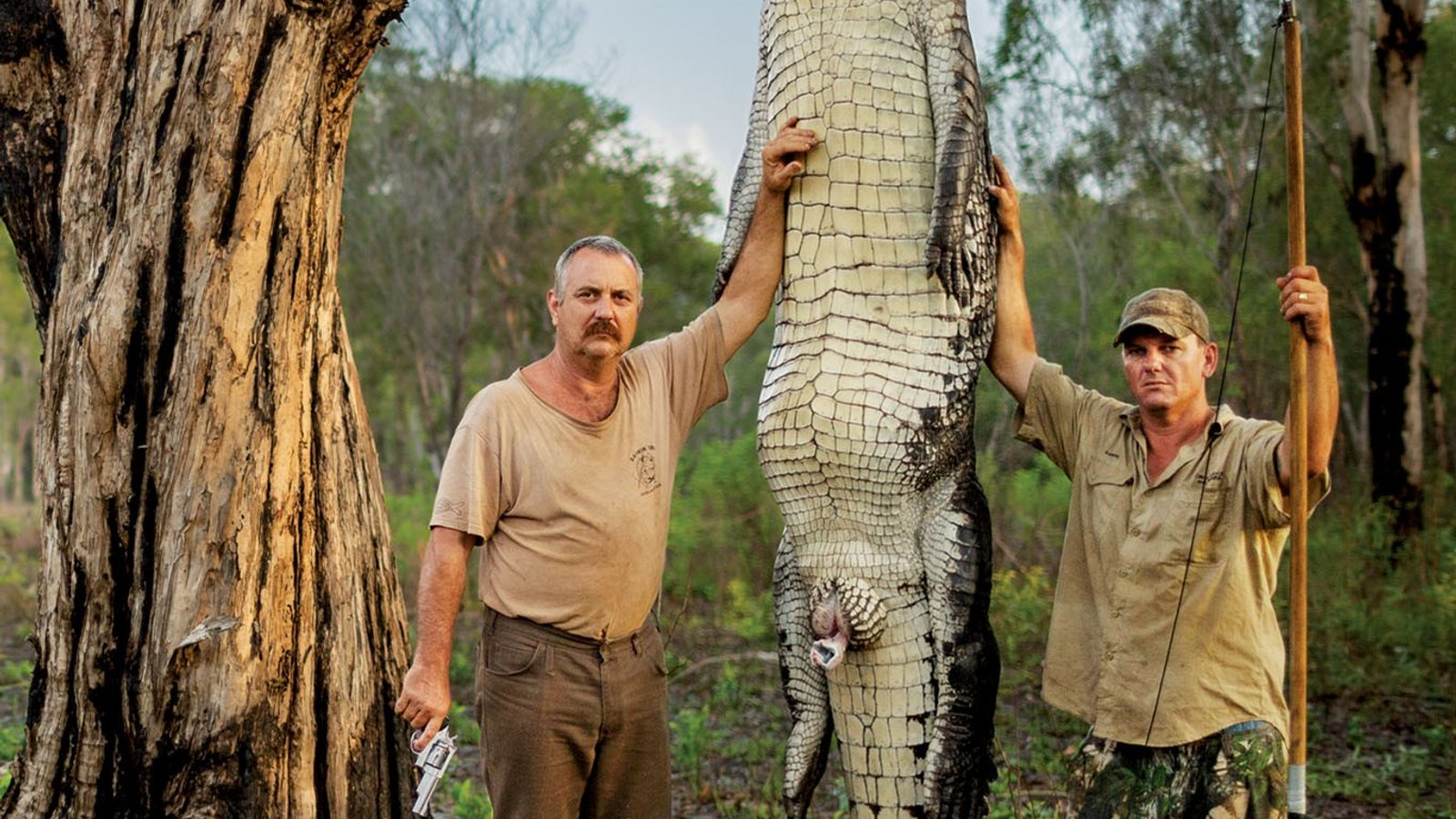 Roger Matthews (left) and Aaron Rodwell stand next to a 15-foot, 1,000-pound saltwater crocodile that they ...