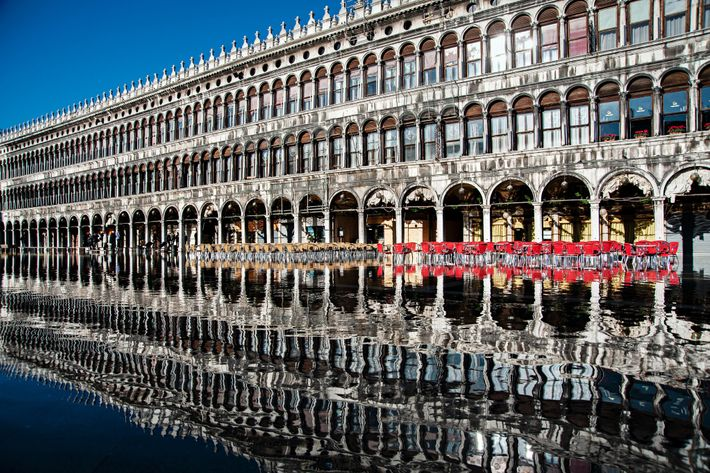 During Venice's seasonal floods, facades in Piazza San Marco appear as shifting reflections—some more clear than ...
