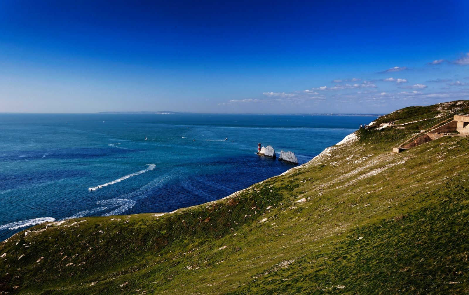 Above Alum Bay and the famous 'Needles' off the coast of the Isle of Wight, the ...