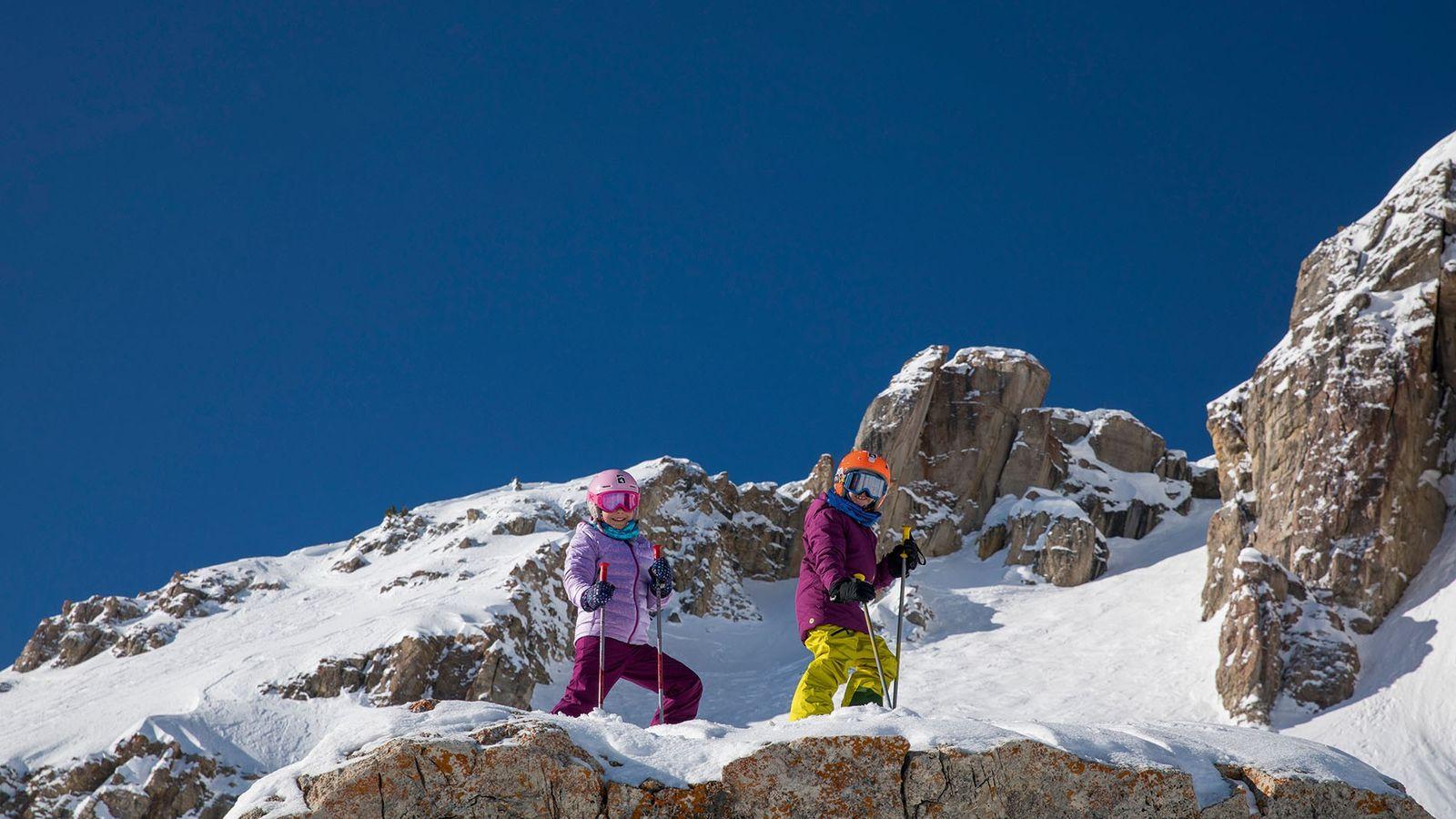 Children skiing on mountainside