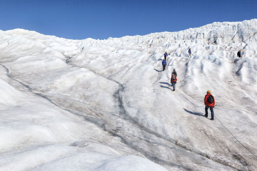 Hiking the Nordenskiöldbreen glacier. There are many guided hikes in Svalbard, from reaching summits to exploring ...
