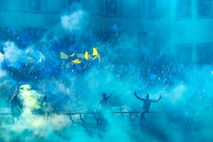 Fans of the Azzurri (Blues) of Santa Croce cheer on their team. Calcio storico includes four ...