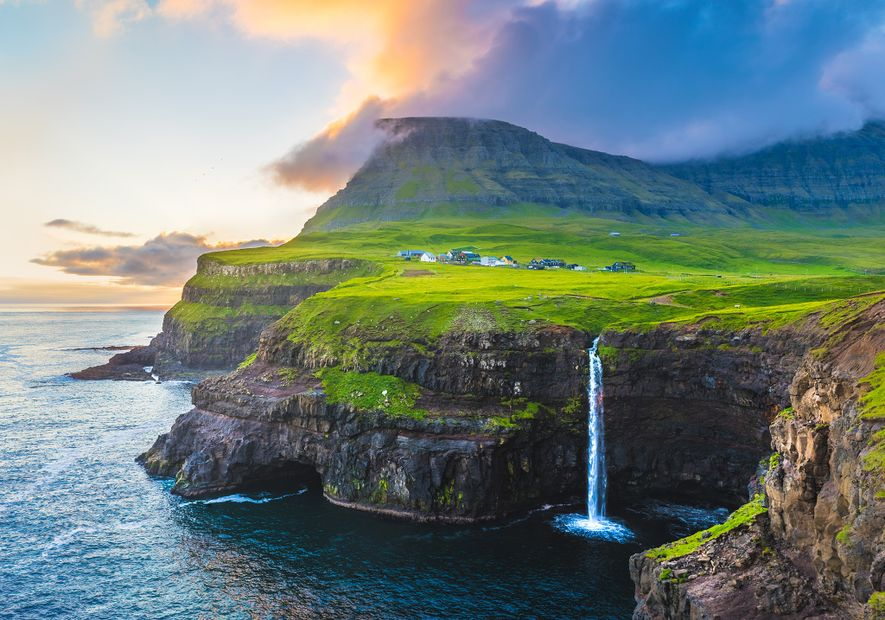 During the summer months, the Faroe Islands' striking landscapes are bathed in dreamy evening light.