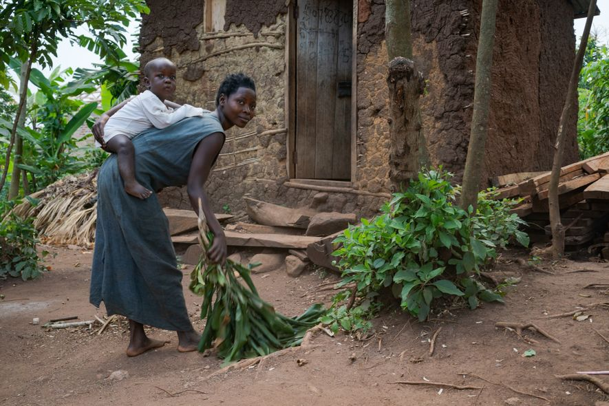 Ahumuza Kyarigonza, here riding safely as his mother sweeps the yard, was snatched from a garden ...