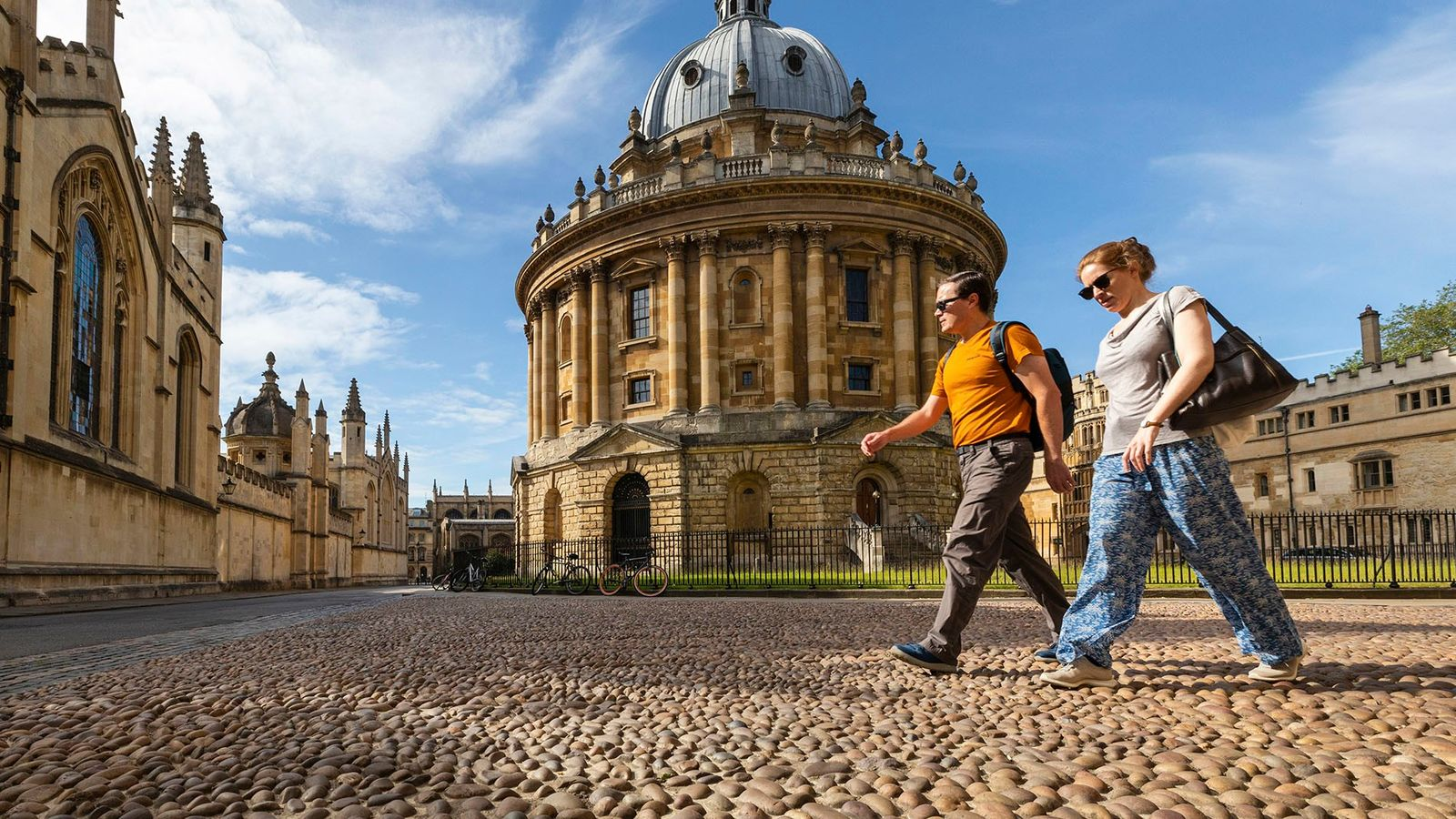 Visitors walk past the Radcliffe Camera, one of the city's most iconic landmarks with over 250 ...