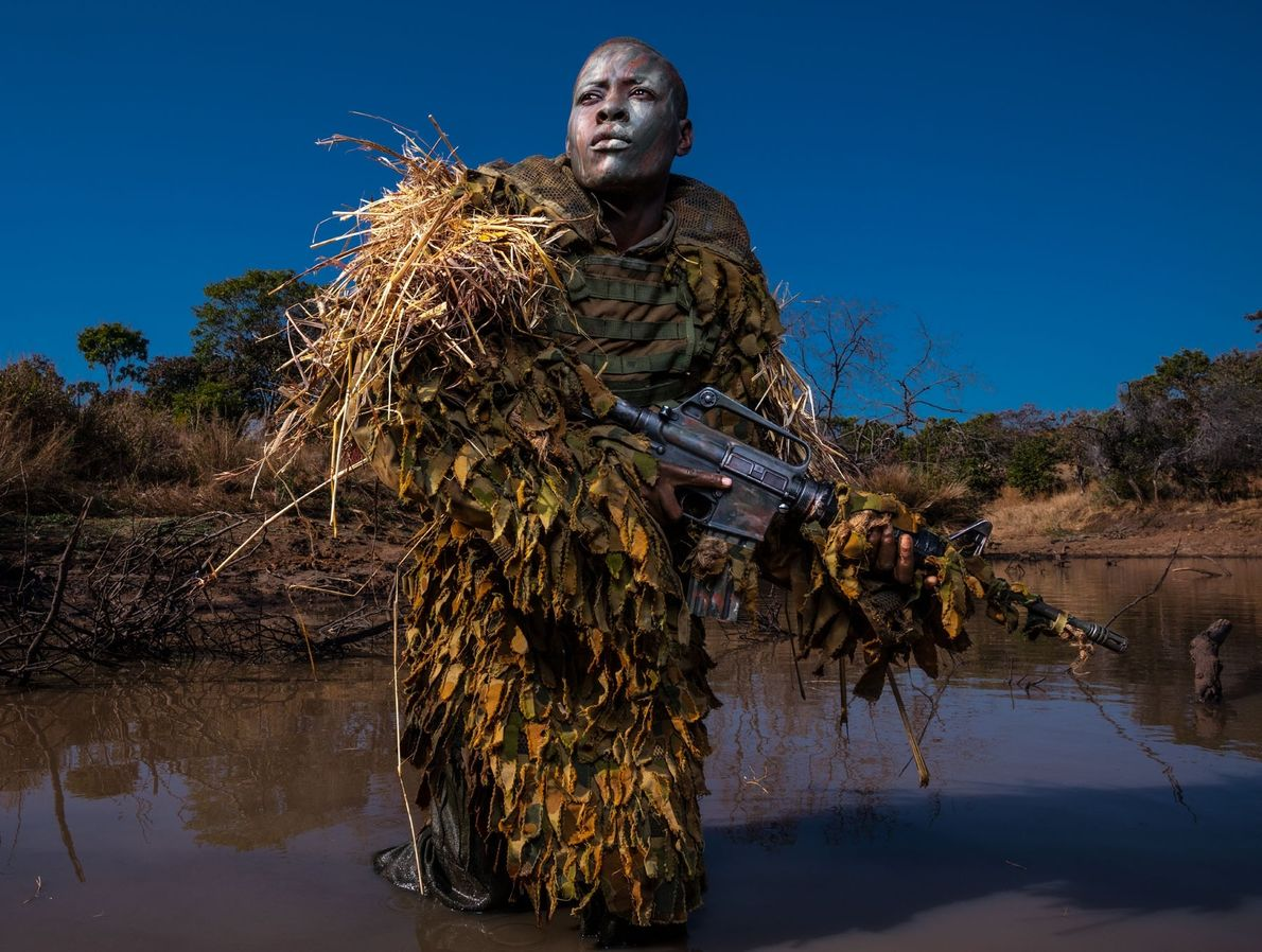 Petronella Chigumbura, a member of the Akashinga—a nonprofit, all-female anti-poaching unit—practices reconnaissance techniques in the Zimbabwean ...