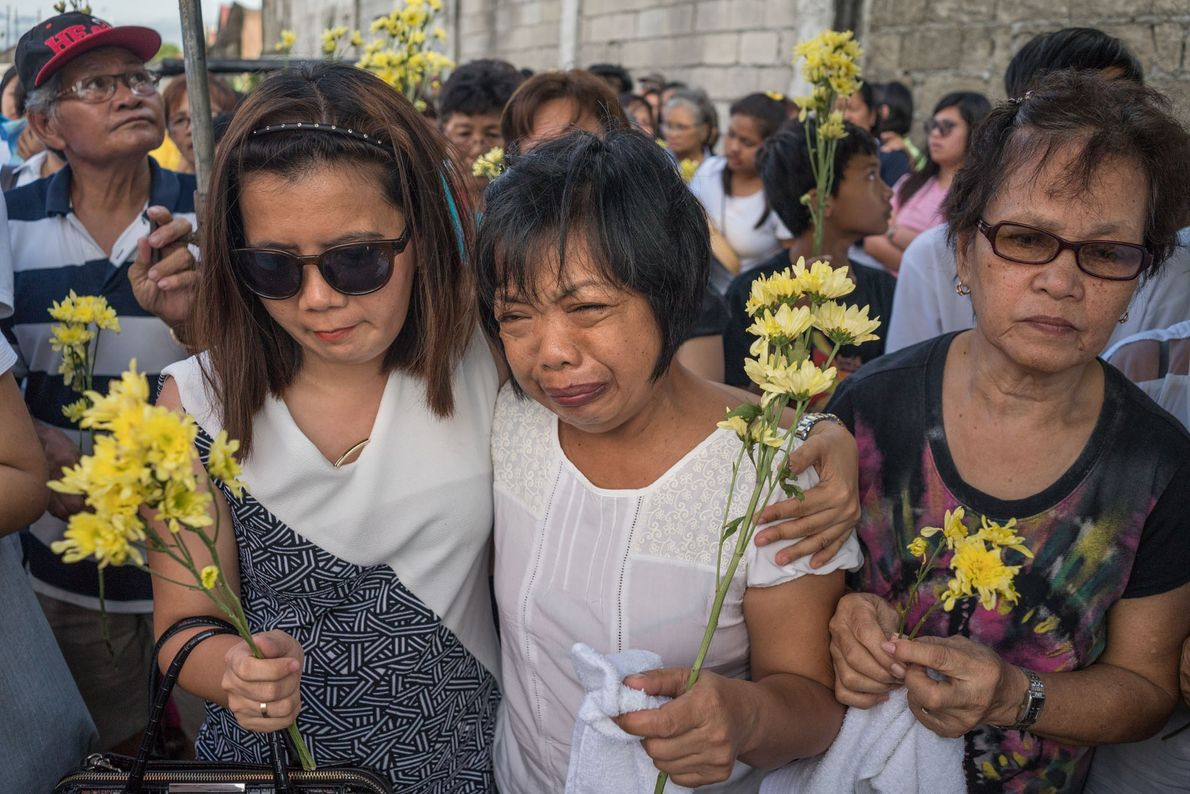 Evelyn (centre), the mother of Jessica Catiis, weeps at her funeral. Evelyn and the rest of ...