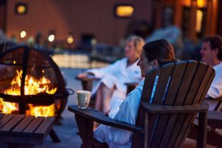 Guests can relax by the fire pit at Thermëa by Nordik Spa-Nature.