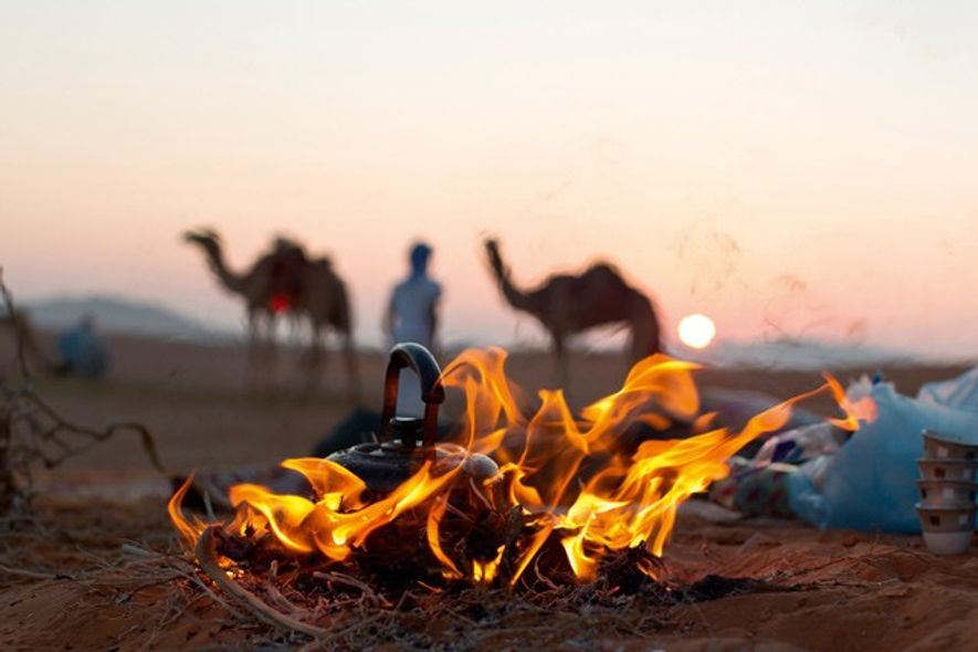 Fireside at dusk, Oman. Image: Getty