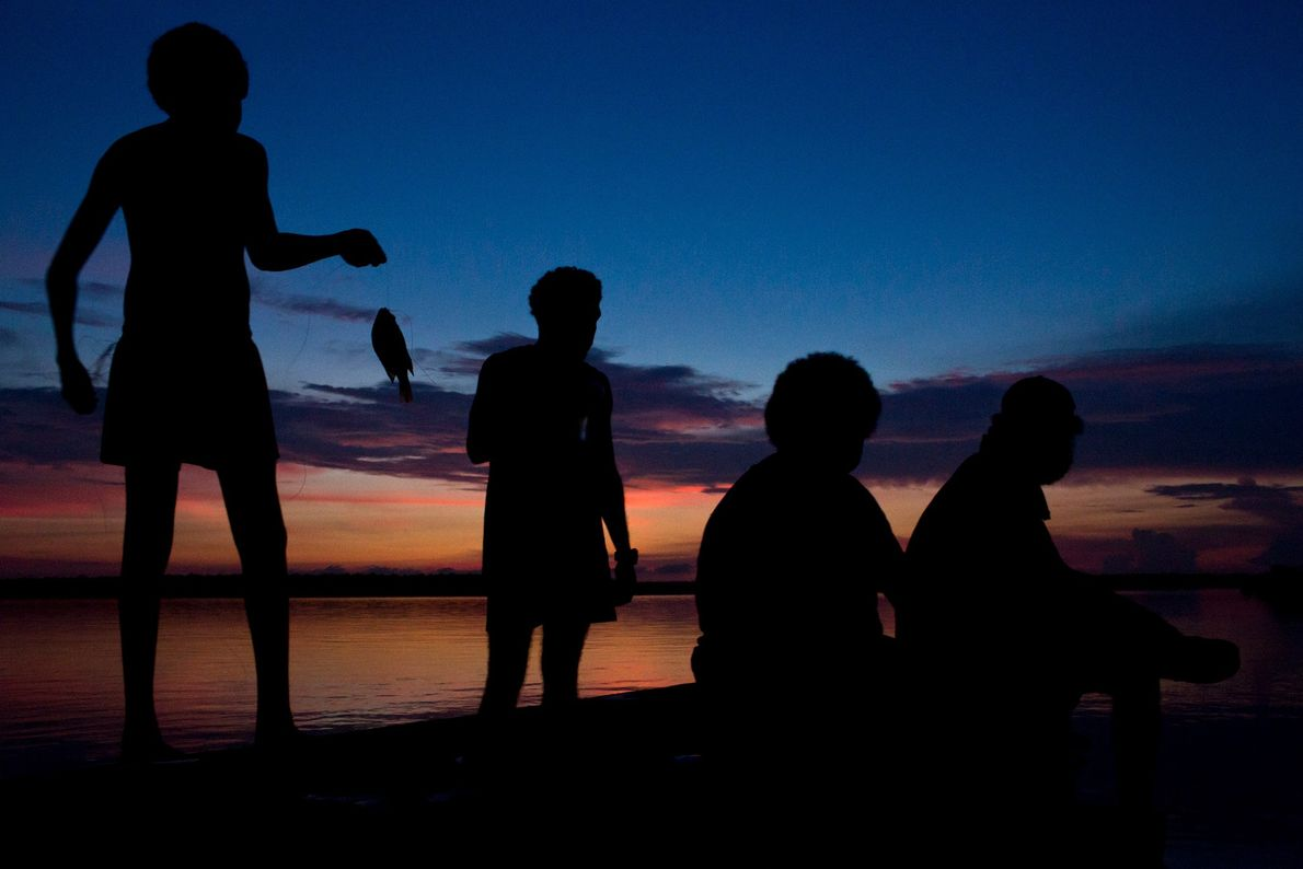 Locals fish at dusk on Melville Island.