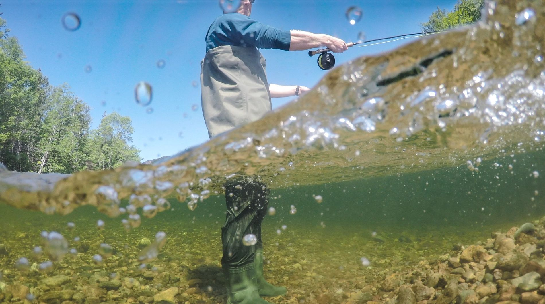 Fish-eye view of an angler in the Margaree River. This world-famous salmon fishery reaches deep into ...