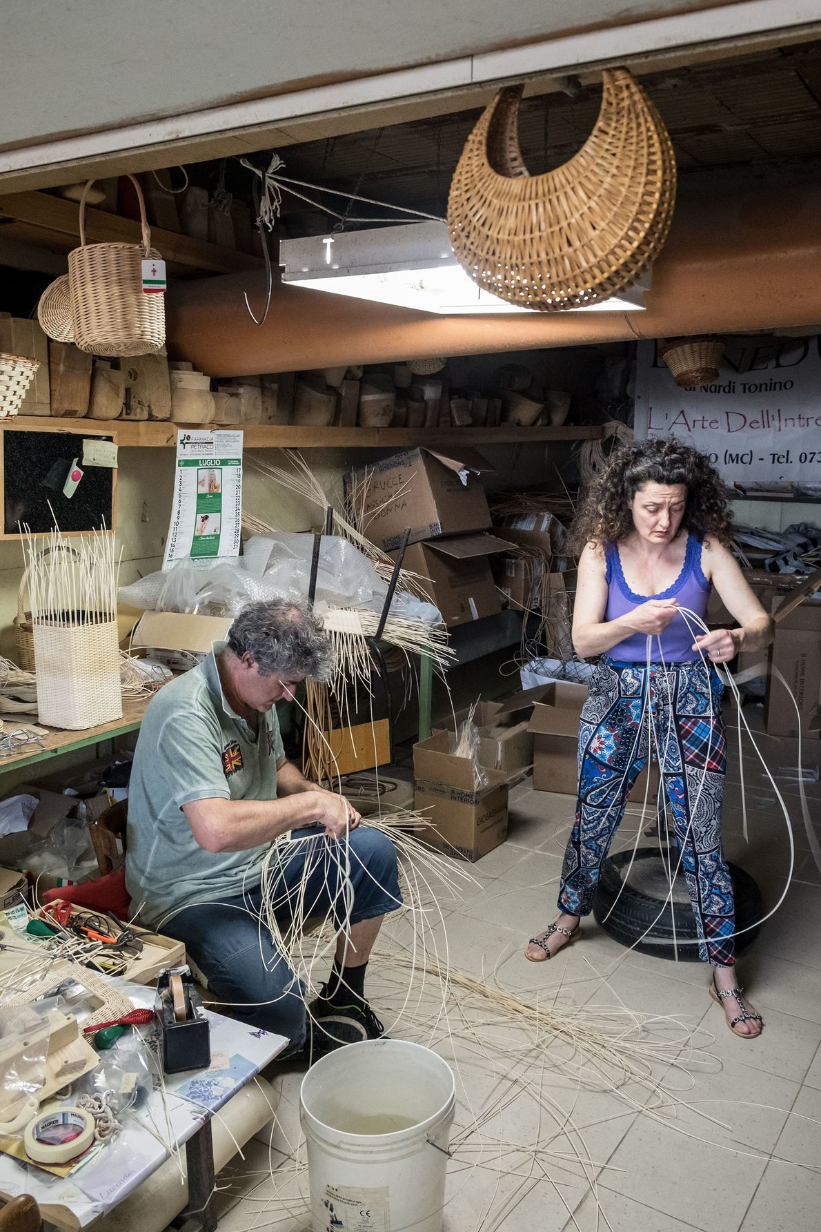 Tonino Nardi and his wife Morena weave bags in the workshop beside their house in Mogliano.