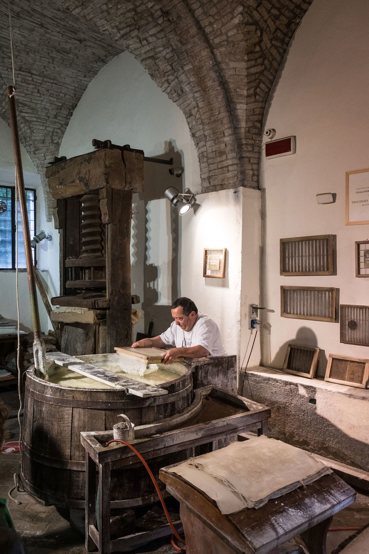 Museum craftsman Mastro Cartaio making paper in Fabriano's Paper and Watermark Museum.