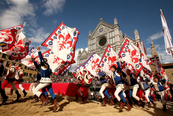 Flag bearers march in the opening ceremony of the 2009 calcio storico final in Piazza Santa ...