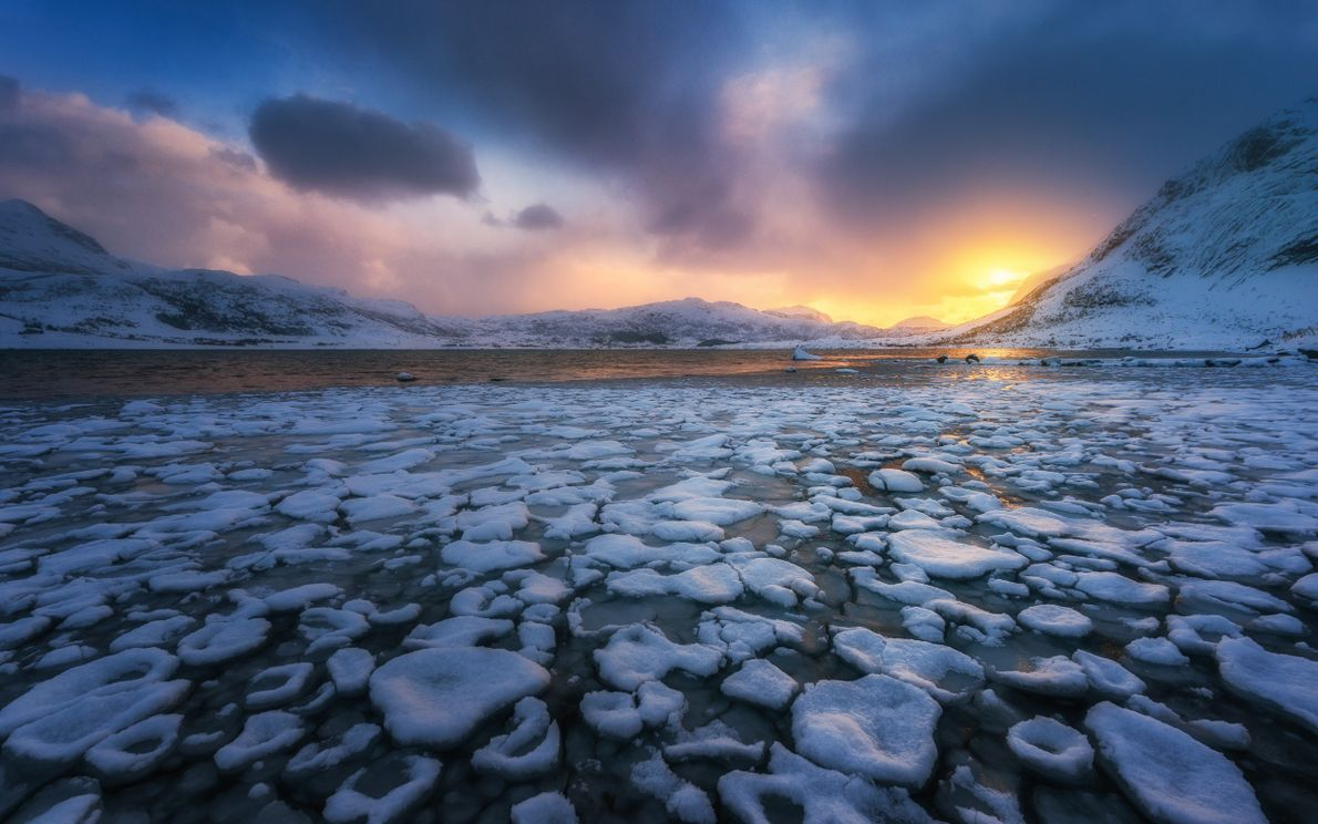 Ice formations in a view towards the fishing village of Nusfjord from Flakstadpollen in winter.  ...
