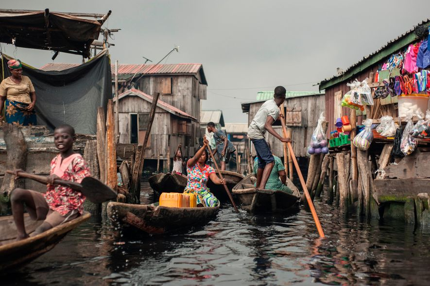 Several hundred thousand people live in a maze of tethered boats and rafts in the Makoko ...