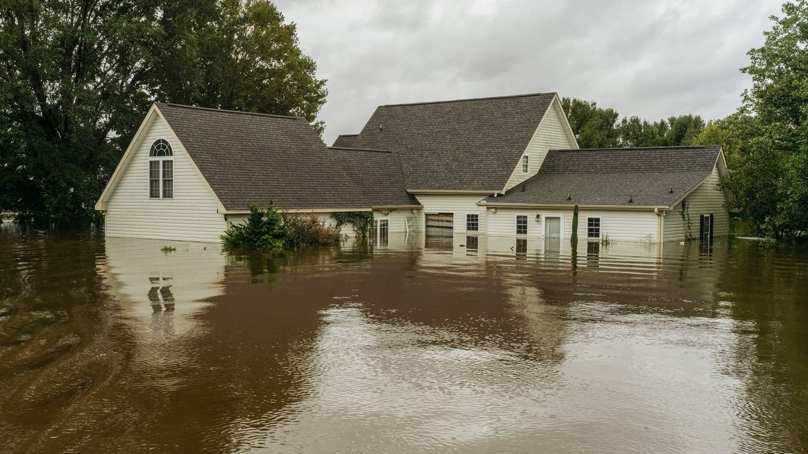 A home is flooded by Thoroughfare Swamp in Goldsboro, North Carolina, after several days of heavy ...