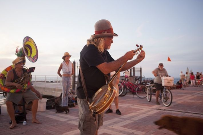 Musicians busking at sunset in Mallory Square, Key West.
