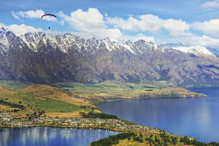 Paragliding over Remarkables Mountain Range, Queenstown, New Zealand