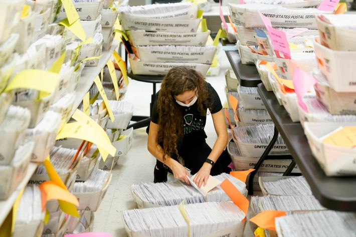 Talai Benducci sorts through mail-in ballots in Paramus, New Jersey, on October 24, 2020. The county ...