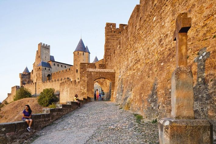 Carcassonne's swashbuckling good looks are partly the result of a 19th-century restoration that added crenellations, conical ...
