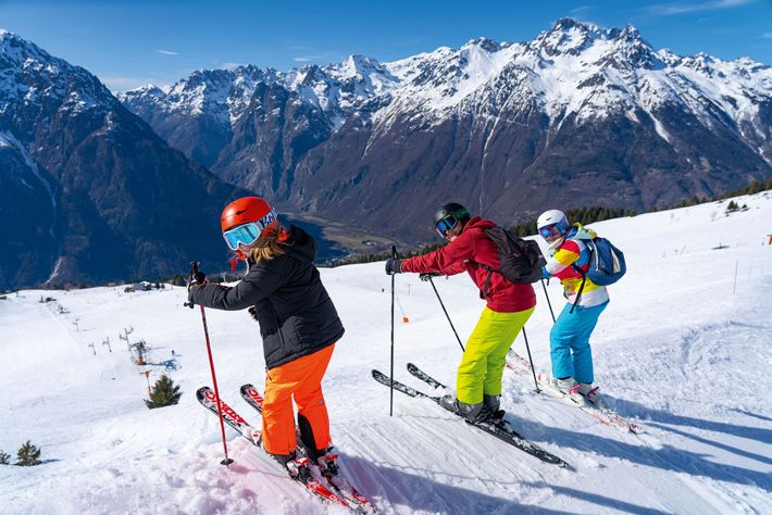Skiiers about to hit a red slope in Villard Recula, France.