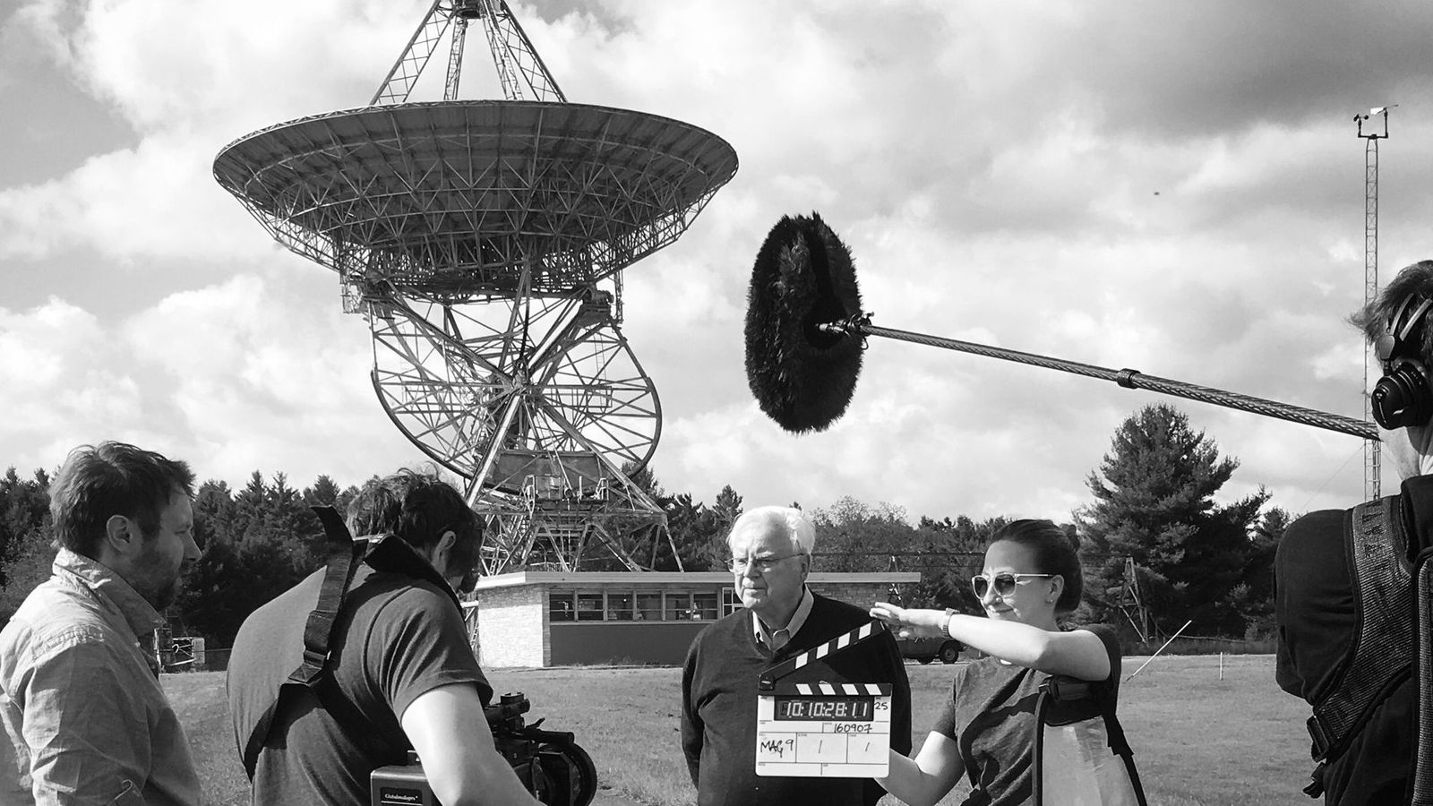 Frank Drake and a BBC film crew at the Green Bank Observatory, with the Ozma telescope ...