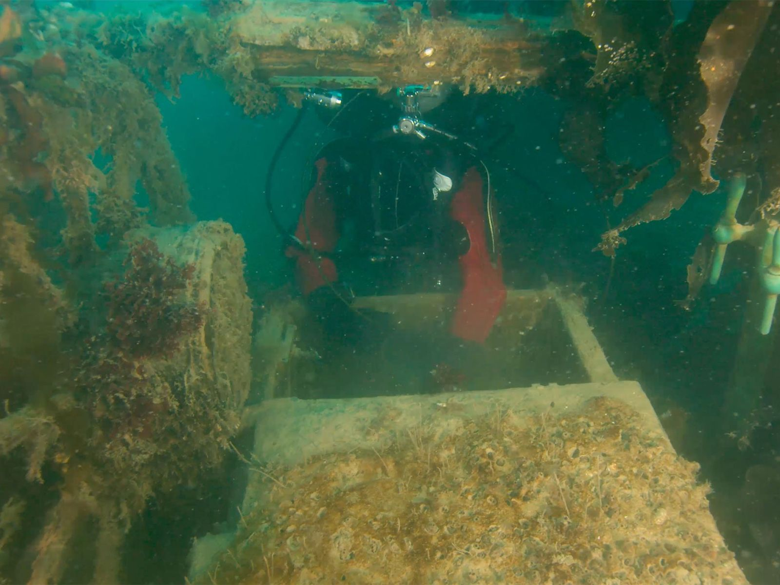 To investigate the lower decks of the H.M.S. Terror, a Parks Canada archaeologist inserts a miniature ...
