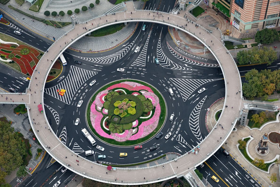 Shanghai, China: An elevated walkway allows pedestrians to survive the Mingzhu Roundabout in Pudong and to …