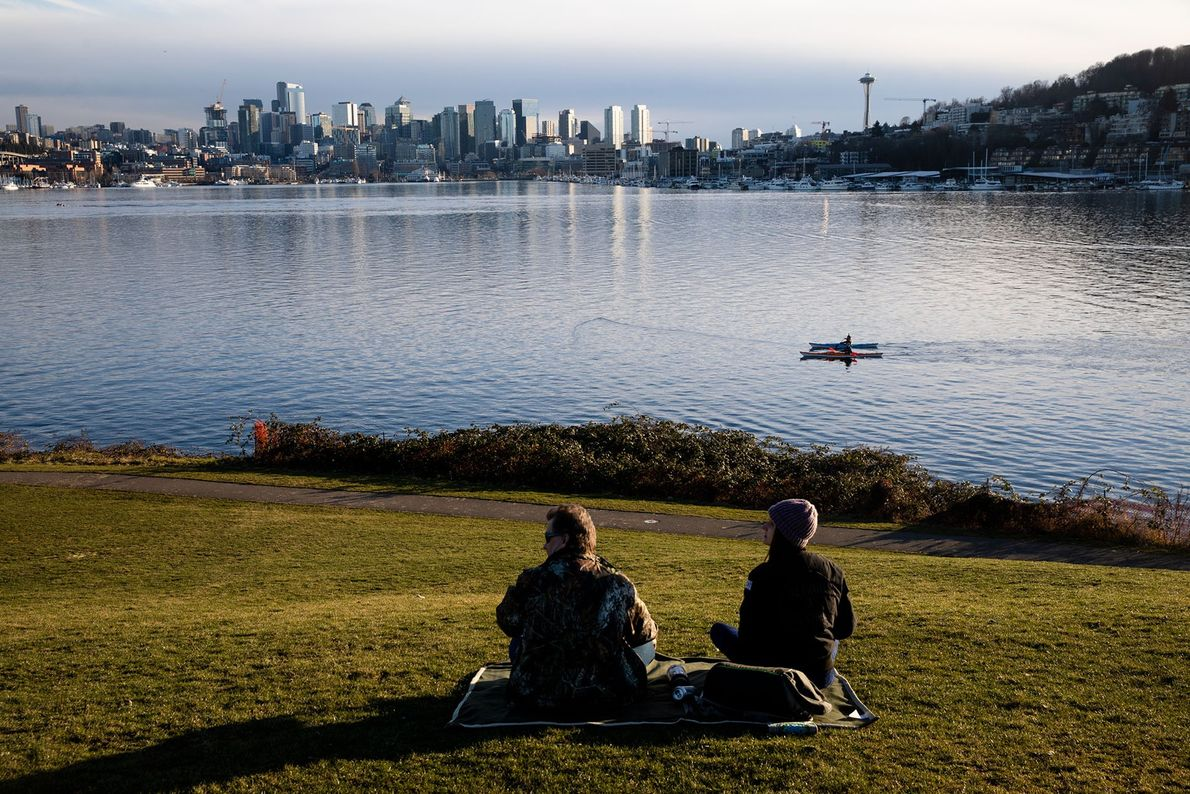 A peaceful sunset in Gas Works Park with the famous Seattle skyline as a backdrop