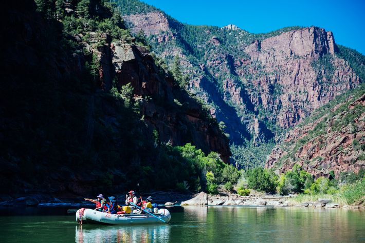 Whitewater rafting down the Green River comes with views of huge red cliffs, emerald-green forests and ...
