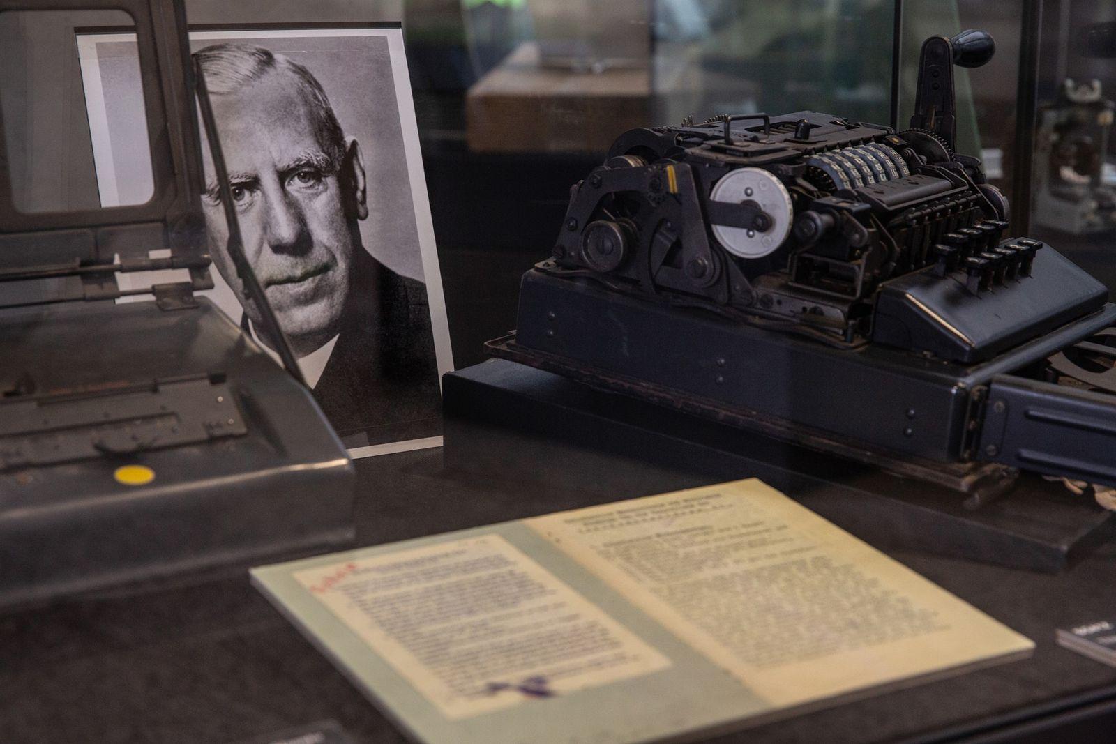 A rare SG-41 (Schlusselgerat 41) cipher machine stands next to a photo of Admiral Wilhelm Franz Canaris. ...