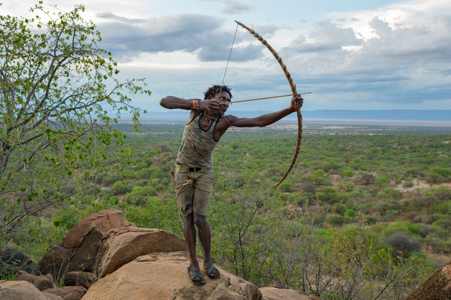 Hadza hunter-gatherers of Tanzania, such as Ondoshi Stephano, are among the closest living relatives of the ...