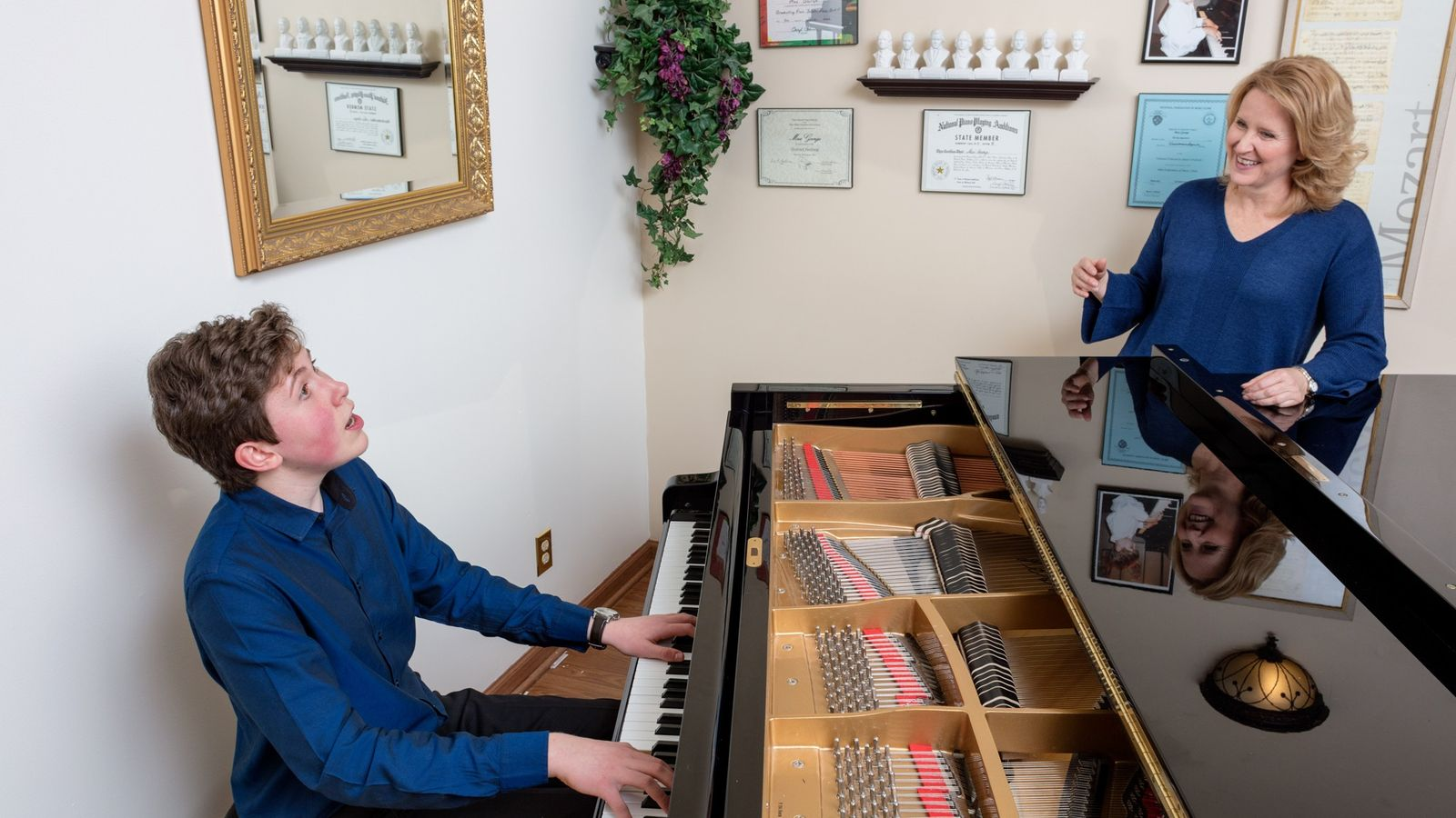 Piano prodigy Gavin George, 14, enjoys playing for his mother, Mary, in their home in Granville, ...