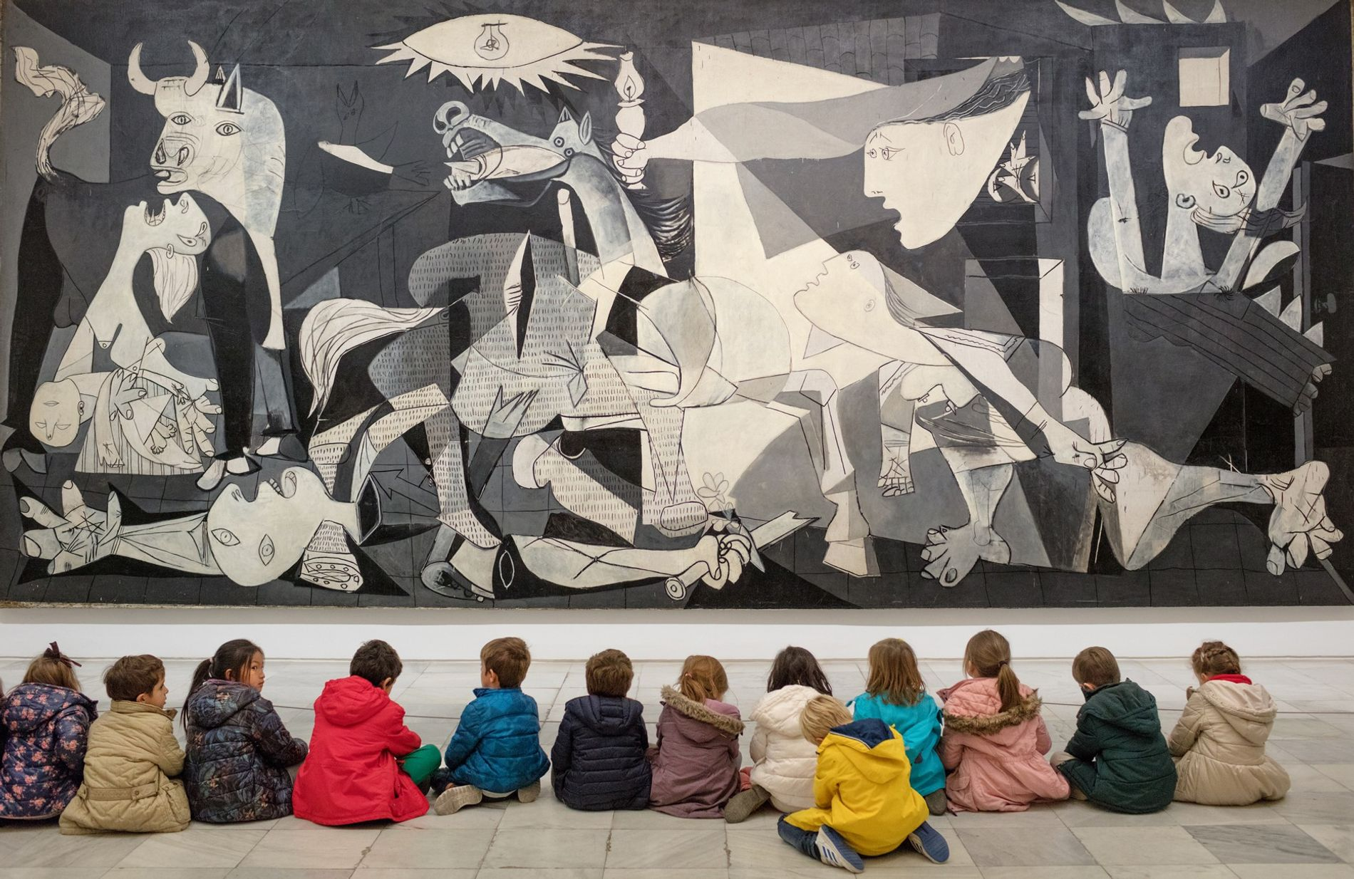 "At Reina Sofía museum in Madrid, schoolchildren visit Picasso's iconic painting ""Guernica,"" which depicts death and anguish in the aftermath of the bombing of the Basque town in 1937. Although precipitated by the Spanish Civil War, the image represents universal suffering, no matter the time or place."