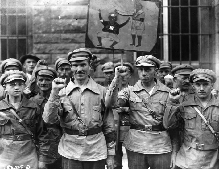 Members of the anti-Nazi Red Front Fighters give the clenched fist salute in 1928. The German ...