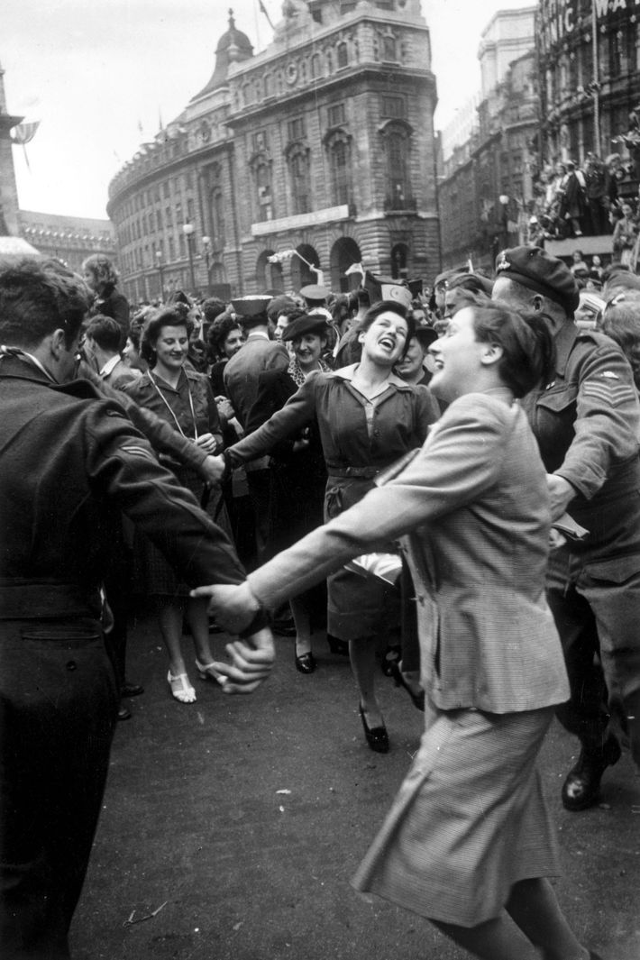 Londoners celebrate Germany's surrender on May 8, 1945—one day before Germany's second, and final, surrender in ...