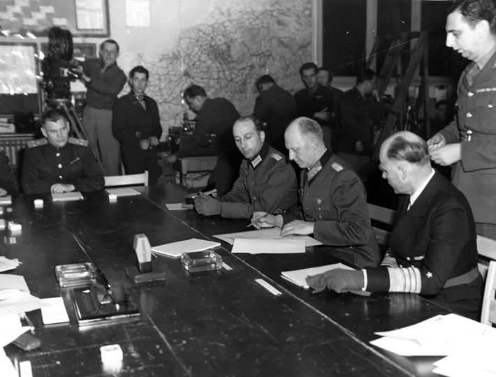 Alfred Jodl, German chief of the operations staff of the Armed Forces High Command, signs an ...