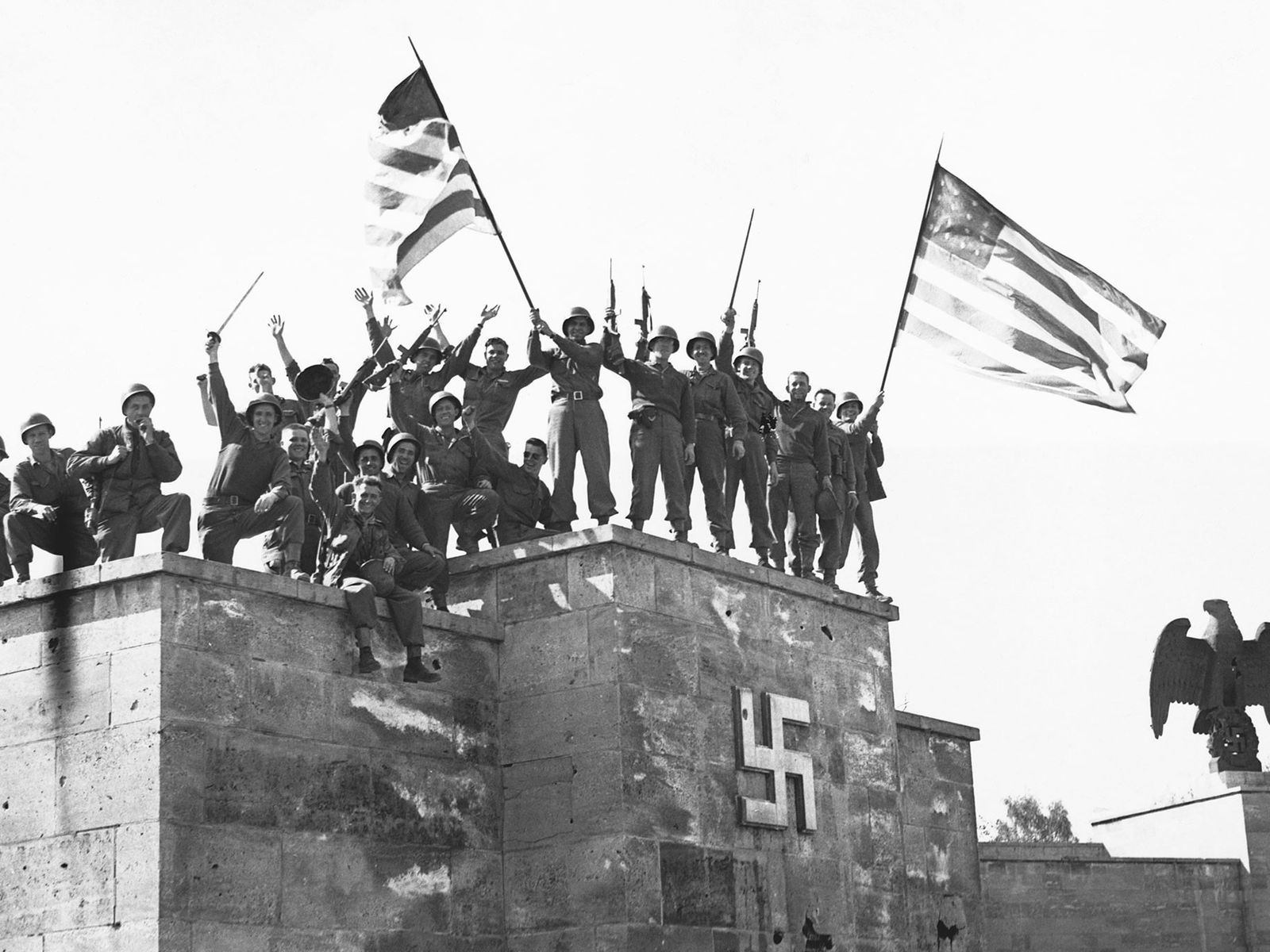 American troops celebrate Germany's first unconditional surrender effective May 8, 1945. To avoid the possiiblity of ...