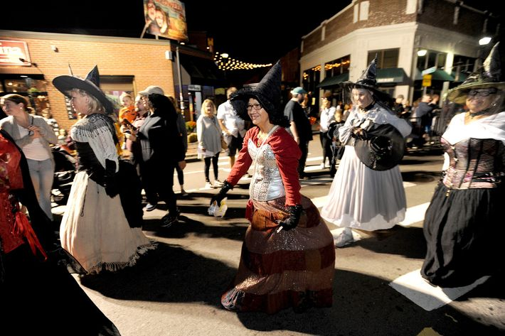 "Locals dressed in witch costumes march in Salem, Massachusetts's annual ""Haunted Happenings Grand Parade"" in 2018. ..."