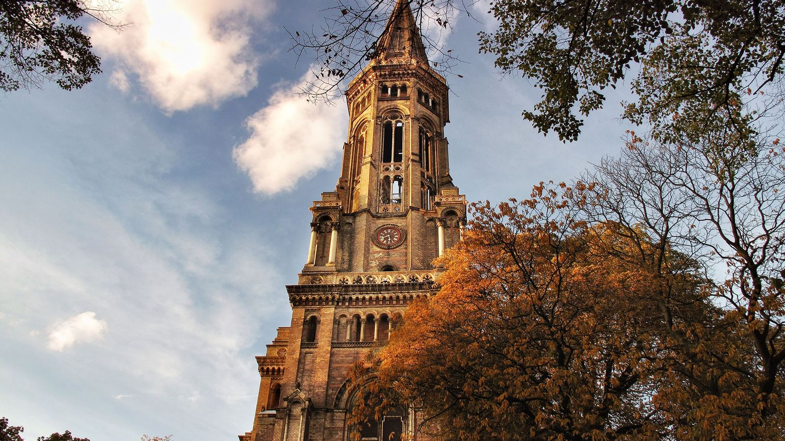 Through a dark brick-and-stone spiral-staircase within, one can reach the top of the Zionskirche and admire ...