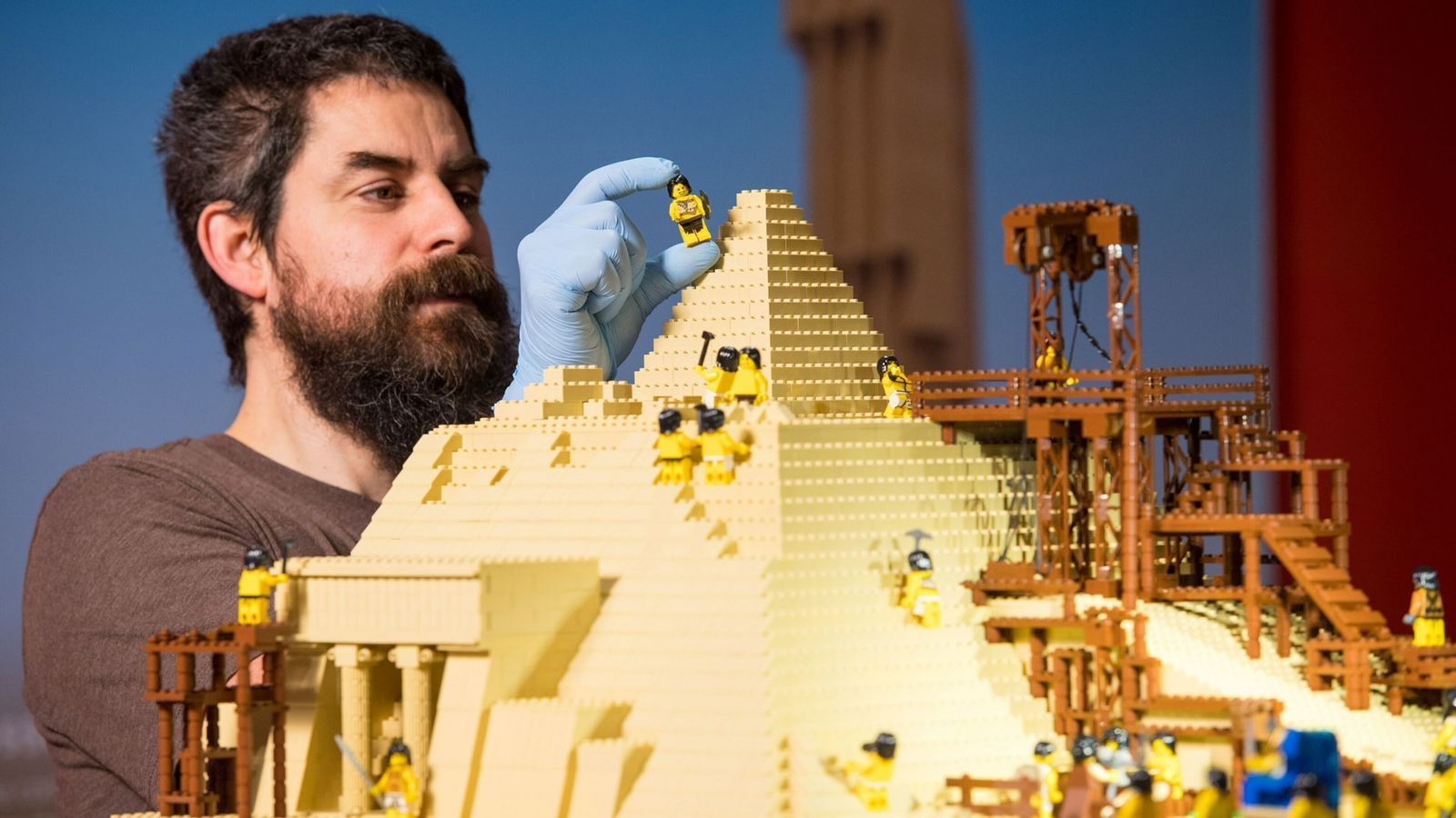 Adult fans of Legos like Phil Sofer, here building a model of the Great Pyramid of ...