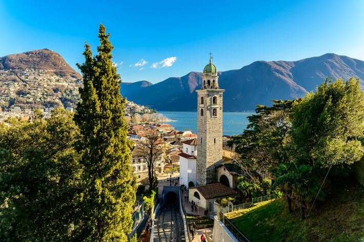 Lugano's hilly, alley-woven historic centre lead to the lakefront promenade, where botanical gardens are flushed pink ...
