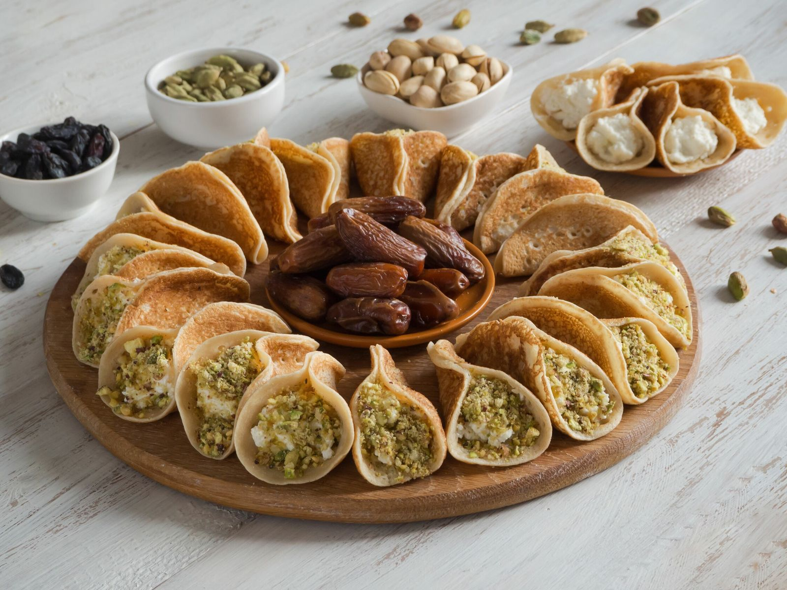 In Egypt, Jordan, Lebanon, Palestine, Syria and the Gulf, a favourite iftar dessert is qatayef, a ...