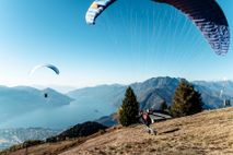 Taking off from Cimetta, 5,482ft above sea level, travellers can soar on mountain thermals and enjoy ...