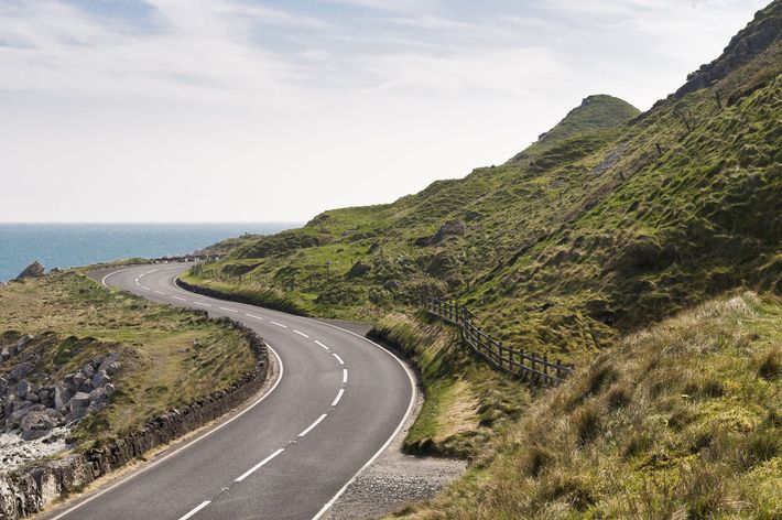 Road by the sea on Causeway Coastal Route in County Antrim, Northern Ireland.